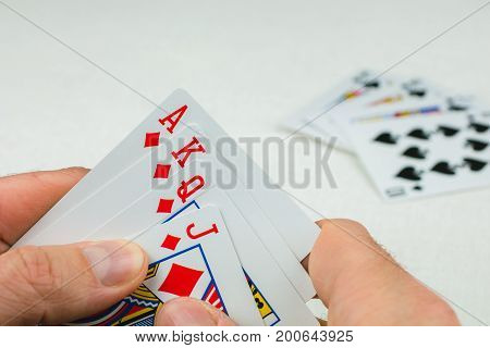 Playing cards in poker. One card more - will be an Royal Flush.