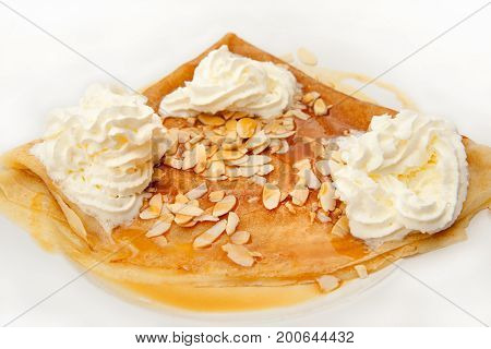 Traditional authentic French crepes with ice cream and almond topping