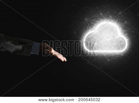 Businessman hand pointing to the luminous cloud computer concept