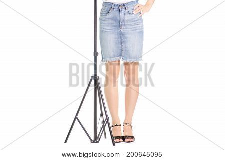 Legs in shoes young girl tripod on white background isolation