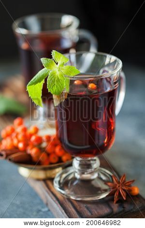 Cup Of Ashberry Tea With Cinnamon And Anise