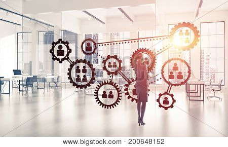 Elegant businesswoman in modern office interior and social connection concept. Mixed media