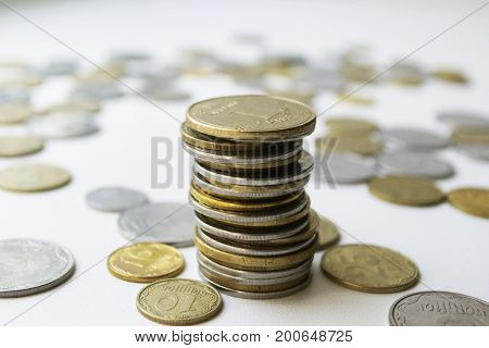 Coins stacked on the white background with another coins