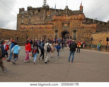 People and castle. Edinburgh, Scotland - July 27, 2017 Tourists and locals are visiting Edinburgh Castle.