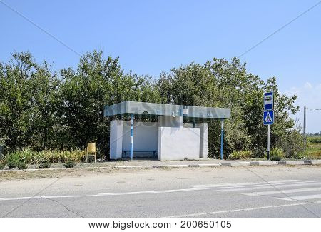 Bus Stop In The Countryside. Rural Landscape.