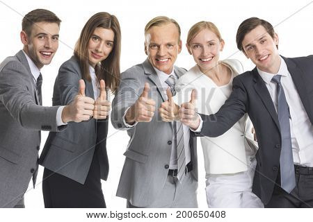 Business team showing thumb up isolated on white background