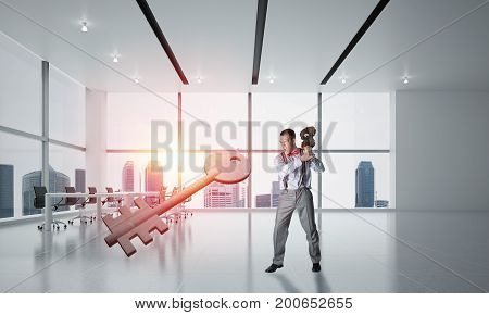 Determined businessman in modern interior breaking with violin stone key figure