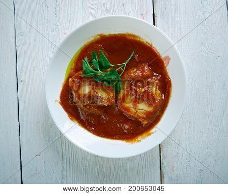 Haraimi Libyan spicy fish dish.Maghreb cuisine Crispy Parmesan Garlic Roasted Baby Potatoes