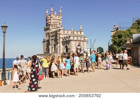 Yalta, Crimea - 11 July, A crowd of visitors on the viewing platform, 11 July, 2017. Small Castle Lastochkino Nest and its surroundings.
