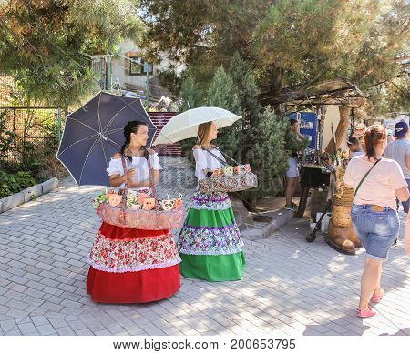 Yalta, Crimea - 11 July, Smart girls with umbrellas, 11 July, 2017. Small Castle Lastochkino Nest and its surroundings.