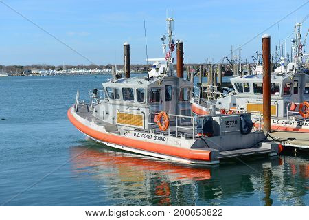 RHODE ISLAND - MAR. 27, 2016: Point Judith Coast Guard 25-Foot Defender Class Boat docked at pier in the station in Galilee, Narragansett, Rhode Island, USA.