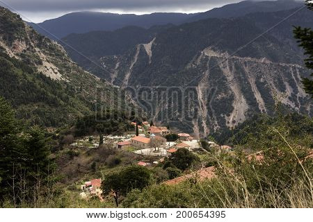 View of a small village in the mountains on a cloudy day