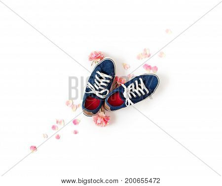 Denim Gumshoes With White Laces Isolated. Pink Rose Petals And Buds Flat Lay.