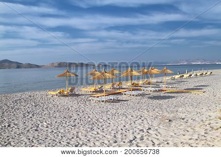 Umbrellas from reed on the evening beach of the island of Kos. Greece