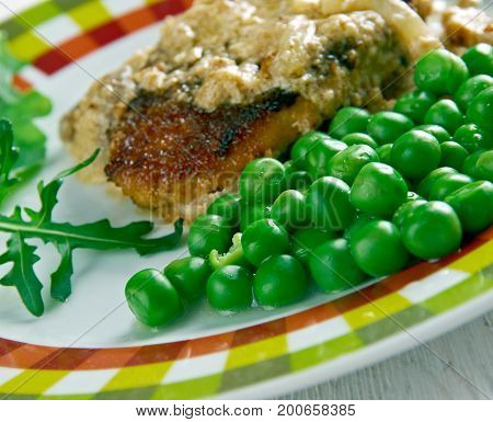 Fried Skinkschnitzel with vegetables. close up meal