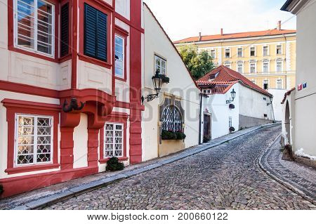 Old medieval narrow cobbled street and small ancient houses of Novy Svet, Hradcany district, Prague, Czech Republic.