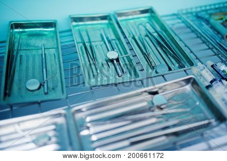 Close-up Photo Of A Wide Range Of Dental Instrument In A Special Container.