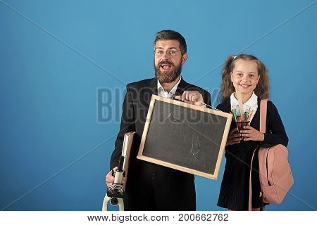 Kid And Dad Hold Microscope, Blackboard, Book And Stationery