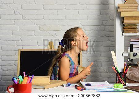 Girl Near Chalkboard, Bookshelf, Microscope And Colorful Stationery