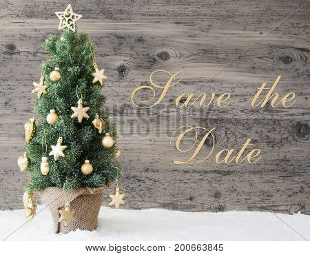 English Text Save The Date. Golden Decorated Christmas Tree With Gray Vintage Background. Rustic Wooden Style With Snow