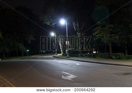 quiet city street with lights at night. background citylife