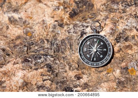 Compass On A Stone Background