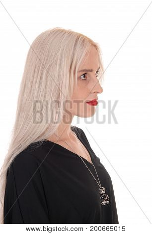 A closeup image of a beautiful young woman with blond long hair and red lips looking serious isolated for white background
