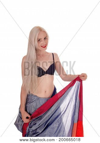 A beautiful blond young woman standing in a black bra and east Indian dress with long blond hair isolated for white background