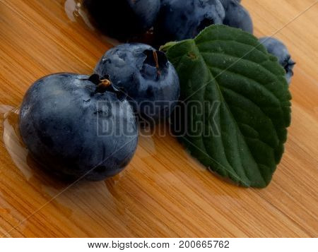 Blueberries isolated on a wooden board close up