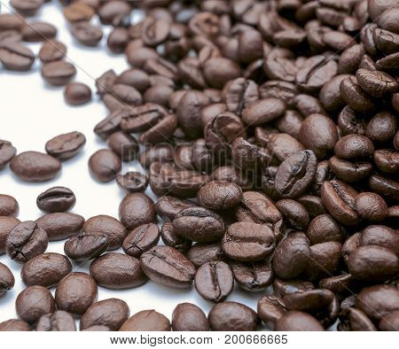 Coffee beans after being roasted with withe bacground