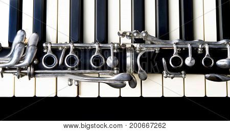 Closeup of a clarinet and keyboard ready to play..