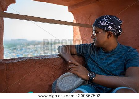 JODHPUR RAJASTHAN INDIA -MARCH 05 2016: Indian tourist looking the amazing view from Mehrangarh Fort in Jodhpur the blue city of Rajasthan in India.