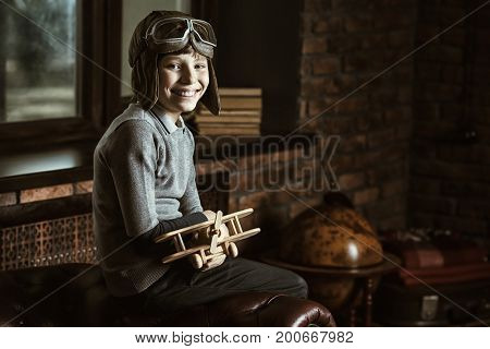 A boy dreams of becoming a great aviator and traveler. Childhood. Fantasy, imagination.
