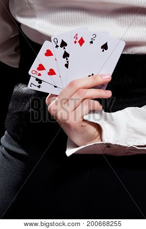 Woman's Hand Holding Playing Cards