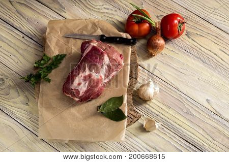 Fillet of raw, fresh pork on a wooden table close-up