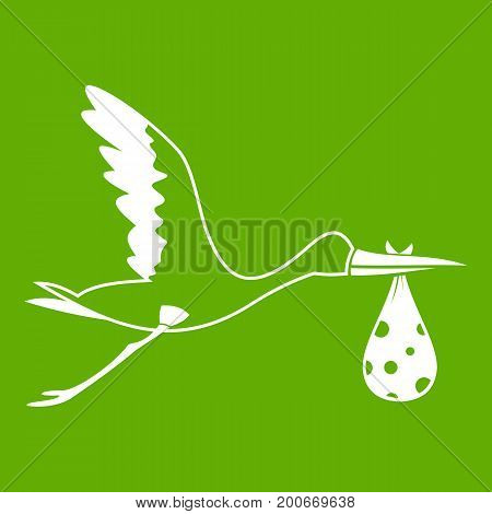 Stork carrying icon white isolated on green background. Vector illustration