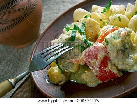 pipe rigate Creamy Cilantro Garlic Chicken close up healthy meal