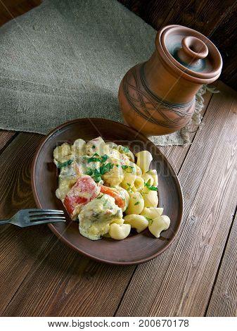 pipe rigate Creamy Cilantro Garlic Chicken, close up healthy meal