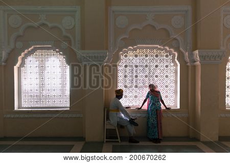 JODHPUR RAJASTHAN INDIA - MARCH 05 2016: Horizontal picture of india couple in a beautiful room at Mehrangarh Fort in Jodhpur the blue city of Rajasthan in India.