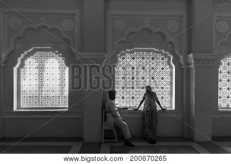 JODHPUR RAJASTHAN INDIA - MARCH 05 2016: Black and white picture of india couple in a beautiful room at Mehrangarh Fort in Jodhpur the blue city of Rajasthan in India.