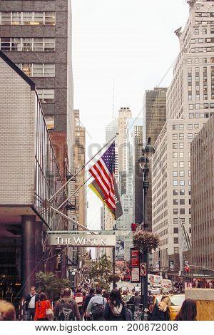 New York USA - September 26 2016: Pedestrians making their way down East 42nd Street in Manhattan NY.