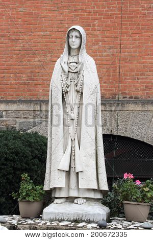 New York USA - September 27 2016: A Statue of Mary outside the Church of St. Anthony of Padua a Catholic parish church in the Roman Catholic Archdiocese of New York located at 155 Sullivan Street