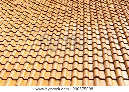 The glazed ceramic roof tile background.The texture of shiny roof tile .