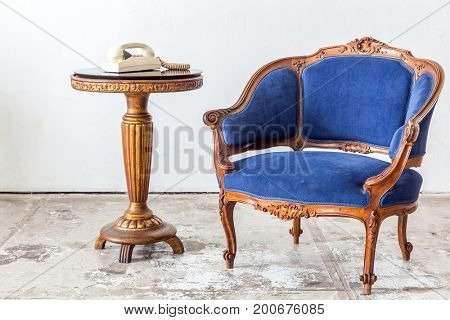 Blue sofa couch in vintage room with vintage telephone - classical style