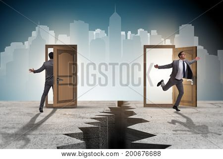 Businessman in teleportation concept with doors