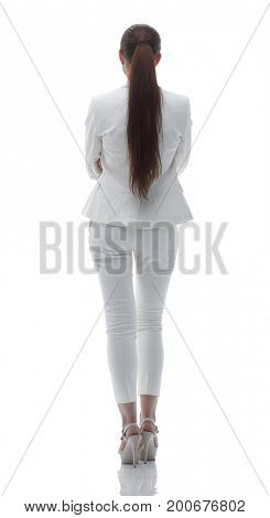 rear view. business lady in white business suit