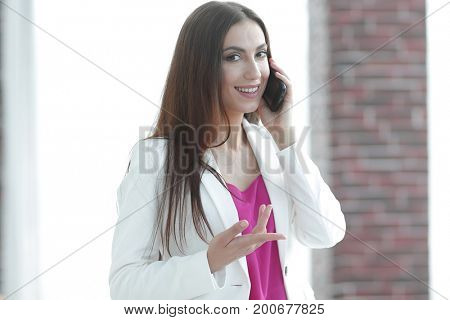 young business woman talking on the smartphone