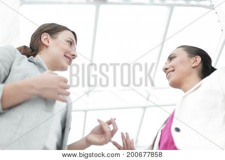 two business women talking in office