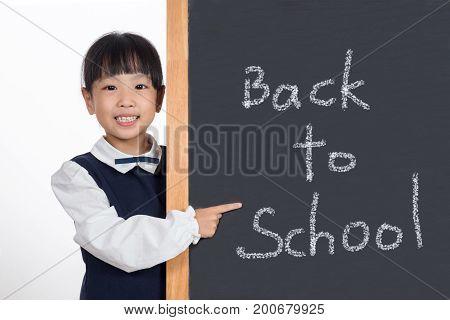 Asian Chinese Little Girl Standing Beside Blackboard