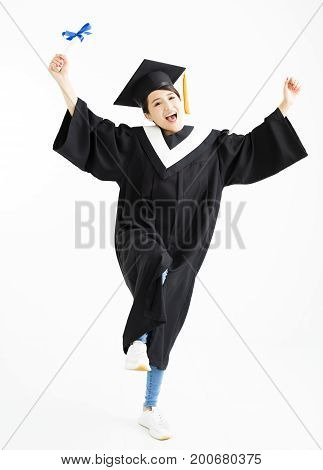 Happy graduation student dancing and showing diploma